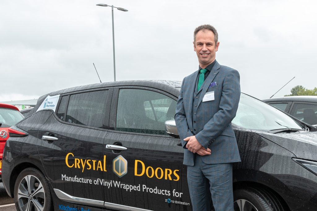 Picture: Richard Hagan, managing director, Crystal Doors, with his electric Nissan Leaf car